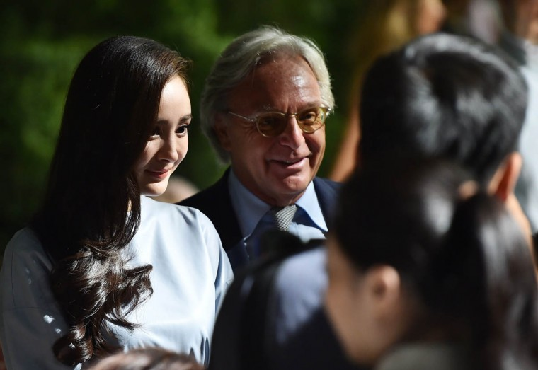 Chinese actress Yang Mi (Left) is welcomed by Diego Della Valle, chief executive of luxury shoe company Tod's before the show during the 2015 Spring / Summer Milan Fashion Week on September 19, 2014 in Milan. (Gabriel Bouys/Getty Images)