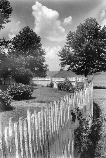 Picket fences lend charm and intimacy to small gardens. This unusual type is to be seen on Jericho Farm at Boonsboro. (A. Aubrey Bodine/Baltimore Sun file)