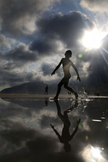 People gather and play on Ipanema beach in Rio de Janeiro, Brazil. Brazil's general elections will be held October 5. (Mario Tama/Getty Images)