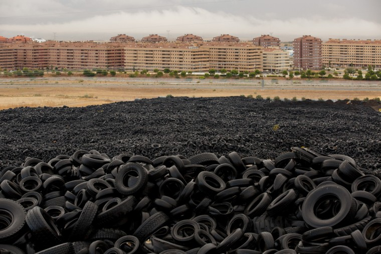 Mountains of used tires lay on a dump in the countryside in Sesena Nuevo, near Madrid, Spain. Used tires dump site in Sesena is a major environmental problem and was declared illegal back in 2003, It currently stores over 75.000 tons of tires. (Pablo Blazquez Dominguez/Getty Images)
