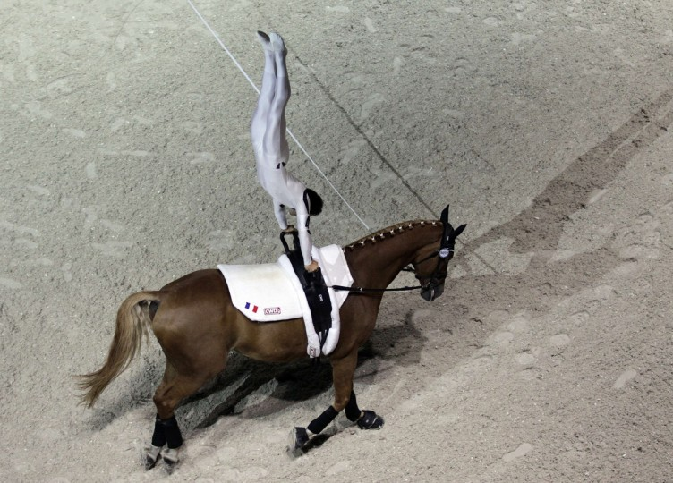 French Nicolas Andreani rides Just a Kiss HN as he competes in the Individual Men Vaulting Compulsory test of the 2014 FEI World Equestrian Games, in the northwestern French city of Caen. (Charly Triballeau/Getty Images)