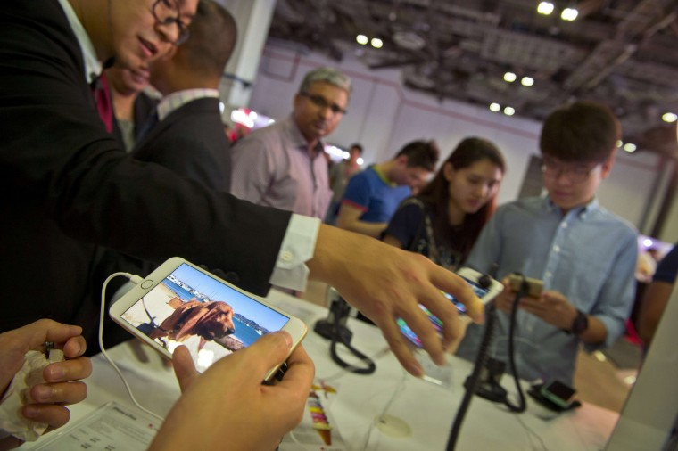 Customers check displays of new iPhone 6 during its launch by Singtel, Singapore telecommunication company in Singapore on September 19, 2014. Singapore is one of the first markets in the world to take delivery of the latest iPhone models which feature large screen handsets. Romeo Gacad/AFP/Getty images