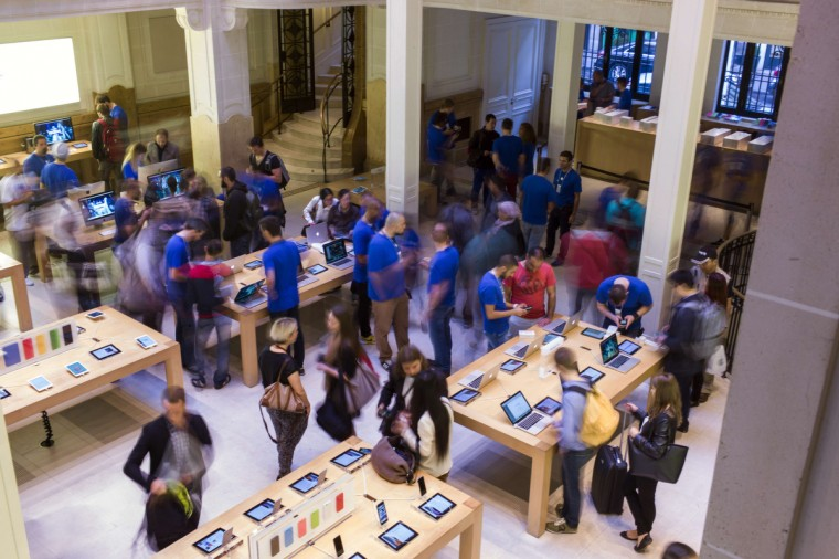 People check items at the Apple Store in Paris on the day of the launch of the latest iPhone, the iPhone 6, on September 19, 2014. Apple says more than four million pre-orders were received in the 24 hours after the sale was announced. Fred Dufour/AFP/Getty images