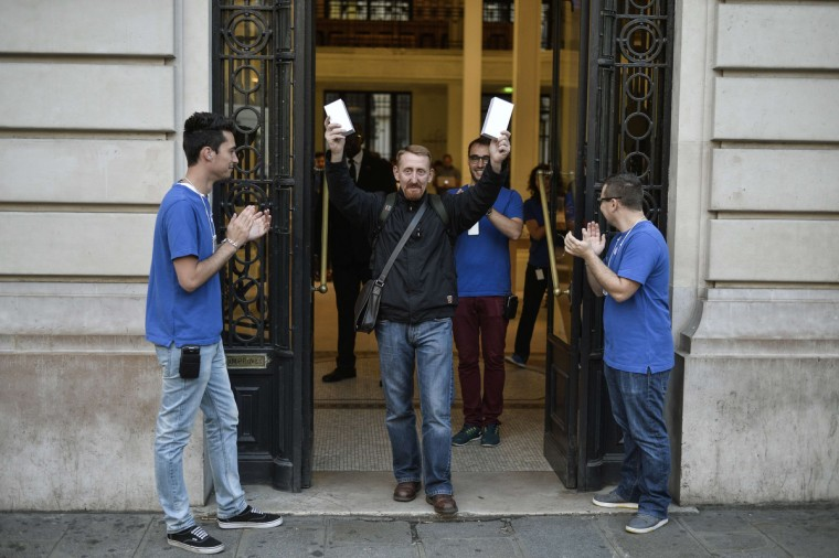 The first French customer to buy the latest iPhone holds two boxes containing the iPhone6, as he exits the Apple Store in Paris, on September 19, 2014. Apple says more than four million pre-orders were received in the 24 hours after the sale was announced. Fred Dufour/AFP/Getty images