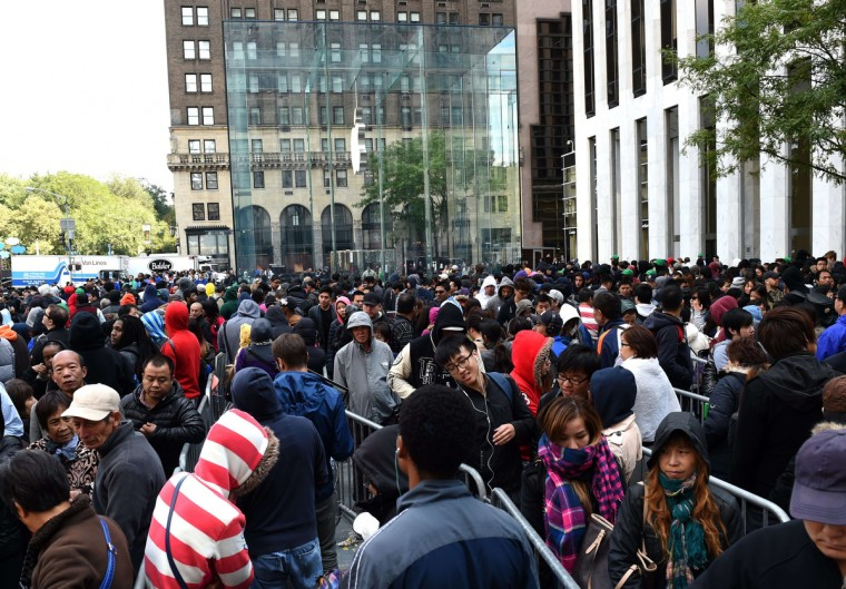 Lines of people wait to get in the Apple store on Fifth Avenue on September 19, 2014 in New York City to purchase the new iPhone 6. The California tech giant has said more than four million pre-orders were received in the 24 hours after the sale of the new devices was announced. Timothy Clary/AFP/Getty Images