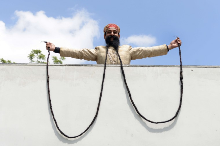 Indian man, Ram Singh Chauhan (61) displays his approximately 18 foot long moustache in Ahmedabad. Ram Singh Chauhan is to be felicitated by the Gujarat Lok Kala Foundation for having the World's Longest Moustache, a feat which has been recognized by the Guinness Book of World Records. (Sam Panthaky/Getty Images)