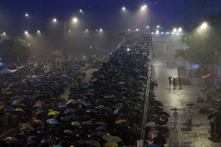 Pro-democracy protestors use umbrellas to shield themselves from heavy rain in Hong Kong on September 30, 2014. Hong Kong has been plunged into the worst political crisis since its 1997 handover as pro-democracy activists take over the streets following China's refusal to grant citizens full universal suffrage. (Anthony Wallace/AFP/Getty Images)