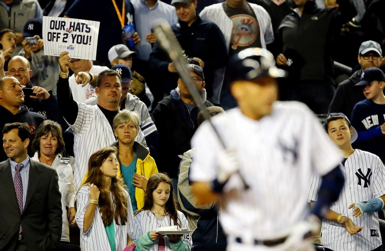 Derek Jeter #2 of the New York Yankees bats as a fan holds up a sign behind him against the Baltimore Orioles during a game at Yankee Stadium on September 25, 2014 in the Bronx borough of New York City. (Al Bello/Getty Images)