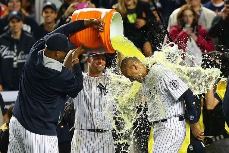 CC Sabathia #52 of the New York Yankees and Brett Gardner #11 dump Gatorade on Derek Jeter #2 after he hit a game winning RBI hit in the ninth inning against the Baltimore Orioles in his last game ever at Yankee Stadium on September 25, 2014 in the Bronx borough of New York City. (Elsa/Getty Images)