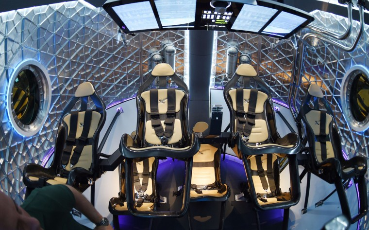 A file picture taken on May 29, 2014 shows the interior of SpaceX's new seven-seat Dragon V2 spacecraft, the companys next generation version of the Dragon ship designed to carry astronauts into space, at a press conference to unveil the space capsule, in Hawthorne, California. With spacecraft that carry tourists into orbit and connect Paris to New York in less than two hours, the new heroes of space travel are not astronauts but billionaire captains of industry. As well as their extreme wealth, this new breed of space pioneers has another thing in common -- they are all using private money to push the final frontier as government space programmes fall away. (Robyn Beck/AFP/Getty Images)