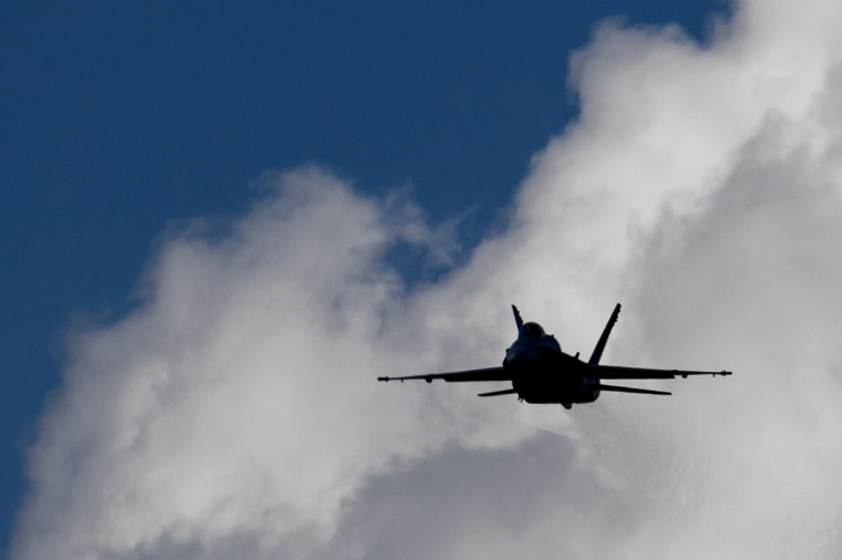 An F/A-18 Hornet fighter jet of the Swiss Air Force takes part in the first day of the AIR14 air show in Payerne, western Switzerland, on August 30, 2014. (FABRICE COFFRINI/AFP/Getty Images)
