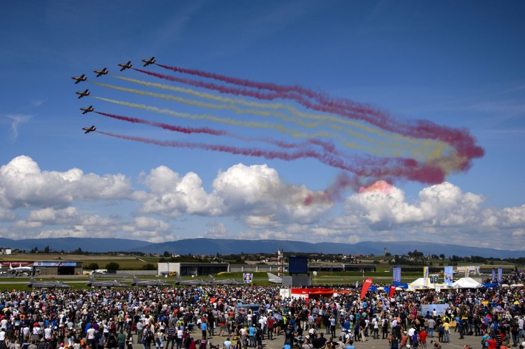 """The Spanish Air Force's """"Patrulla Aguila"""" aerobatic team performs on the first day of the AIR14 air show in Payerne, western Switzerland, on August 30, 2014. (FABRICE COFFRINI/AFP/Getty Images)"""