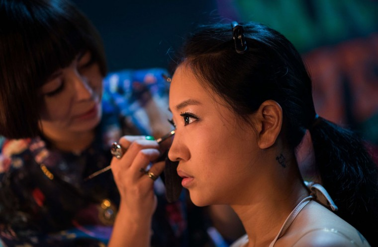Leng Yuting (C), 26, having make up for her underwater photo shoot at studio in Shanghai, ahead of her wedding next year. (Johannes Eisele/AFP/Getty Images)