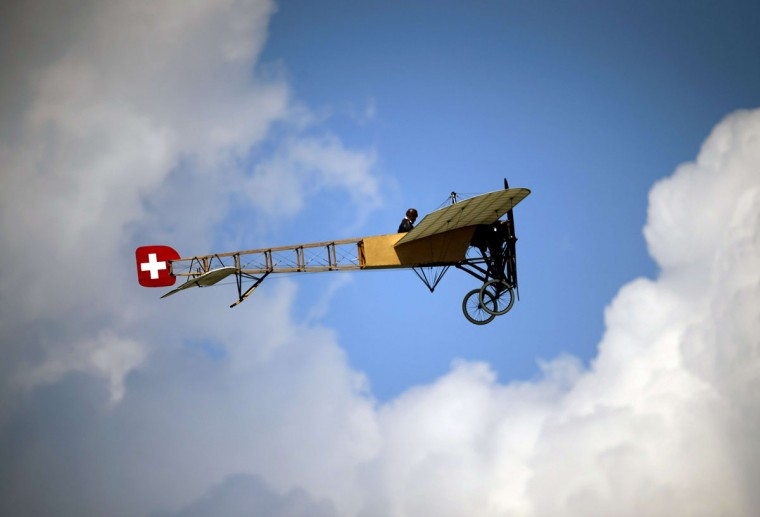 A Bleriot XI-2, the first model used by Swiss Air Force, flies during the second weekend of the AIR14 air show on September 6, 2014 in Payerne, western Switzerland. (FABRICE COFFRINI/AFP/Getty Images)