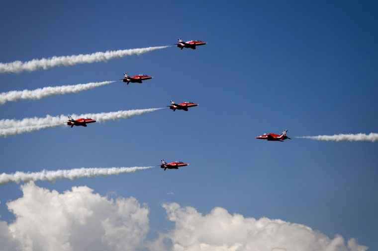 Britain's Red Arrows airplane display team performs during the second weekend of the AIR14 air show on September 6, 2014 in Payerne, western Switzerland. (FABRICE COFFRINI/AFP/Getty Images)