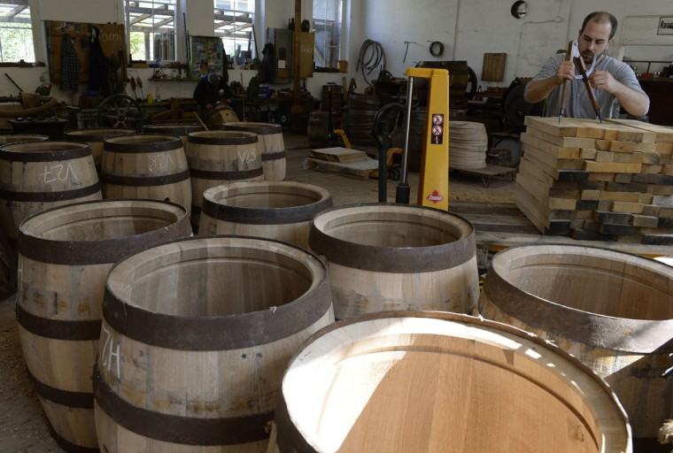 Cooper Peter Schmid produces beer barrels made of oak wood at the barrel factory Schmid in Munich, southern Germany, on September 8, 2014. (Christof Stache/AFP/Getty Images)