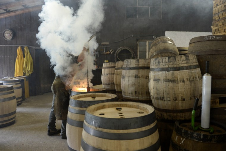 Cooper Joerg Schnepper burns signatures in new beer barrels made of oak wood at the barrel factory Schmid in Munich, southern Germany, on September 8, 2014. The barrel factory produces about 1,000 beer barrels with capacities of ten to 200 liters per year. For this year's edition of the traditional Oktoberfest beer festival, which will be running from September 20 to October 5, 2014, the company has produced 50 new barrels for the different breweries of the city. (Christof Stache/AFP/Getty Images)