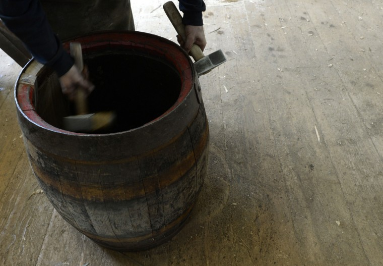 Cooper Peter Grassy refurbishes an old beer barrel at the barrel factory Schmid in Munich, southern Germany, on September 8, 2014. (Christof Stache/AFP/Getty Images)