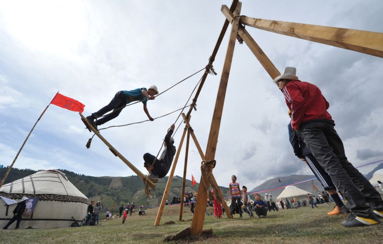 Kyrgyz boys on a swing during the first World Nomad Games in the Kyrchin (Semenovskoe) gorge, some 300 km from Bishkek. (Vyacheslav Oseledkov/AFP/Getty Images)