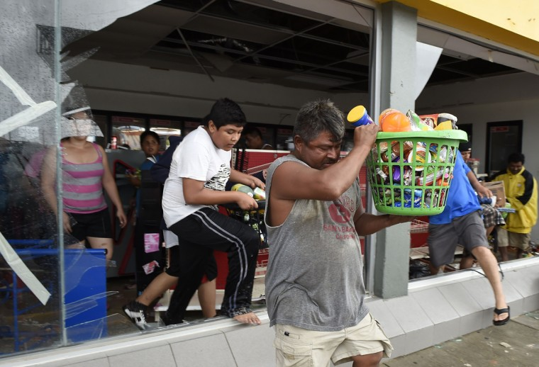 People loot a supermarket in Cabo San Lucas on September 15, 2014 after hurricane Odile knocked down trees and power lines in Mexico's Baja California peninsula. Odile weakened to category two on the five-level Saffir-Simpson scale but still packed powerful winds of 175 kilometers (110 miles) per hour after crashing ashore overnight near Cabo San Lucas, according to the US National Hurricane Center. Some 24,000 foreign tourists and 6,000 Mexican beachgoers spent the night in hotels where conference rooms were transformed into shelters. (Donaldo Schemidt/AFP/Getty Images)