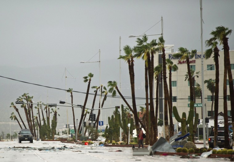 View of main road leading to Cabo San Lucas seen after hurricane Odile knocked down trees and power lines in the city, in Mexico's Baja California peninsula, on September 15, 2014. Odile weakened to category two on the five-level Saffir-Simpson scale but still packed powerful winds of 175 kilometers (110 miles) per hour after crashing ashore overnight near Cabo San Lucas, according to the US National Hurricane Center. Some 24,000 foreign tourists and 6,000 Mexican beachgoers spent the night in hotels where conference rooms were transformed into shelters. (Donaldo Schemidt/AFP/Getty Images)