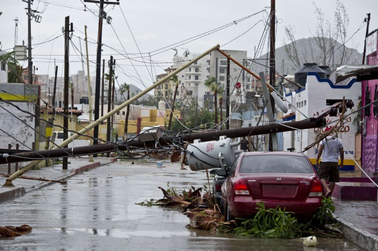 Picture of a street in Cabo San Lucas taken after hurricane Odile knocked down trees and power lines in this city in Mexico's Baja California peninsula, on September 15, 2014. Odile weakened to category two on the five-level Saffir-Simpson scale but still packed powerful winds of 175 kilometers (110 miles) per hour after crashing ashore overnight near Cabo San Lucas, according to the US National Hurricane Center. Some 24,000 foreign tourists and 6,000 Mexican beachgoers spent the night in hotels where conference rooms were transformed into shelters. (Donaldo Schemidt/AFP/Getty Images)