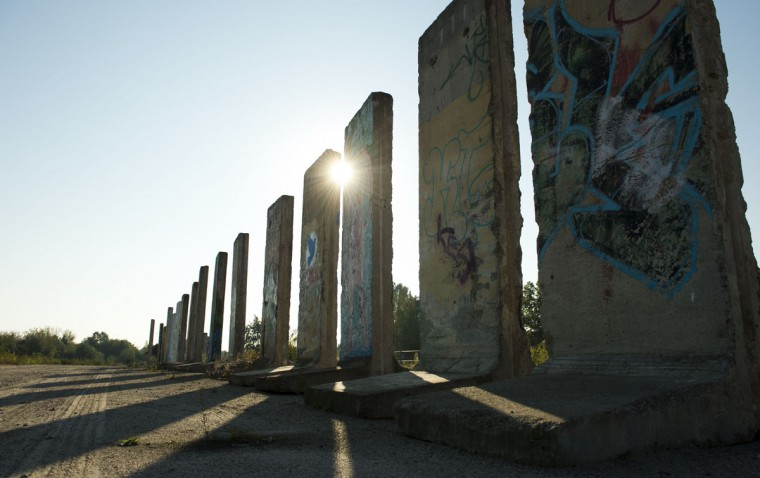 Cement slabs that used to make up the Berlin wall stand in a vacant lot in Teltow outside of Berlin on September 18, 2014. A construction company purchased parts of the wall that can be painted legally after applying for it. (Photos by John MacDougall/AFP/Getty Images)