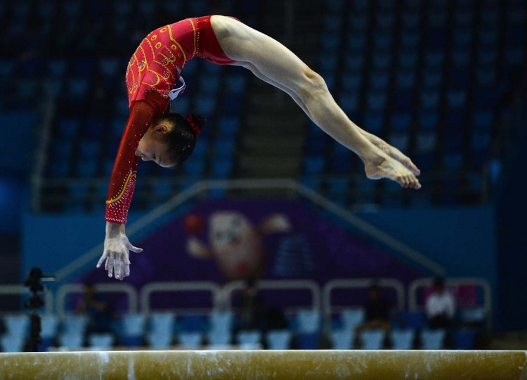 China's Shang Chunsong performs on the balance beam at the Namdong Gymnasium during the artistic gymnastics women's qualification and team final of the 2014 Asian Games in Incheon on September 22, 2014. (Indranil Mukherjee/AFP/Getty Images)