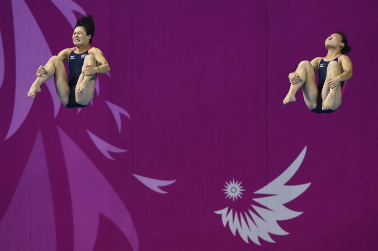 Choe Ung-Yong (R) and Kim Jin-Ok (L) of North Korea compete in the women's 3m springboard final event of the 17th Asian Games in Incheon on September 29, 2014. (Ed Jones/AFP/Getty Images)