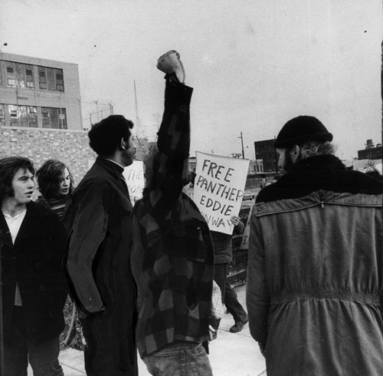 About 25 mostly white young people picketed the city jail in support of 76 inmates who rioted the day before. Chanting slogans and waving placards to the men inside, the group included Mrs. Judy Turco, wife of the man jail officials have accused of planning the riot. Clenched-fist salutes brought verbal responses from jail. (Sun file photo/1971)