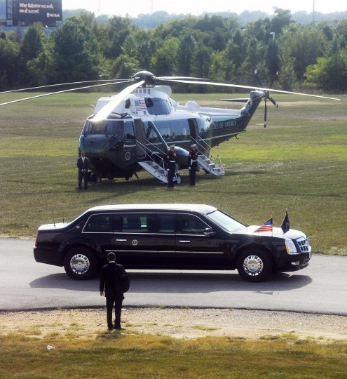 The presidential helicopter is in the background as the limousine carrying President Barack Obama leaves after he landed at Sun Park. (Barbara Haddock Taylor/Baltimore Sun)
