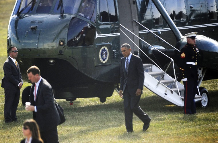 President Barack Obama walks toward a waiting limousine after landing in his helicopter at Sun Park this afternoon. (Barbara Haddock Taylor/Baltimore Sun)
