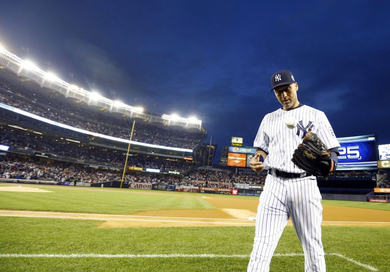 New York Yankees shortstop Derek Jeter (2) warms up prior to the game against the Baltimore Orioles at Yankee Stadium. (William Perlman/NJ Advance Media for NJ.com via USA TODAY Sports)