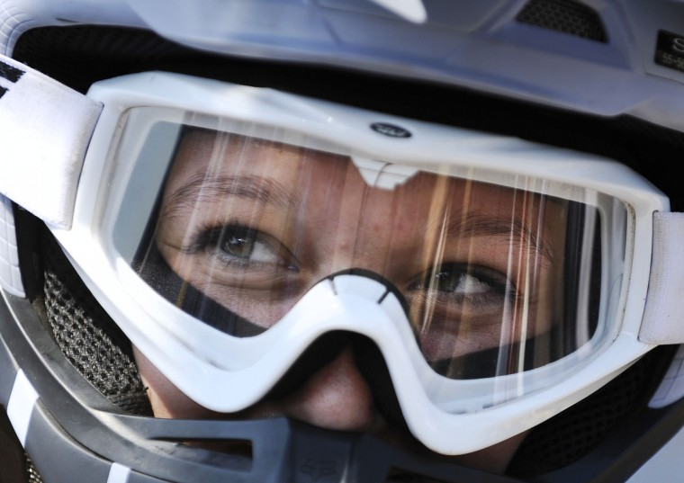 Ashton Raum, 19, of Clear Spring, smiles under her biking gear as she waits in line to practice for the Quaker State National races in Pottstown, PA. Rachel Woolf/Baltimore Sun