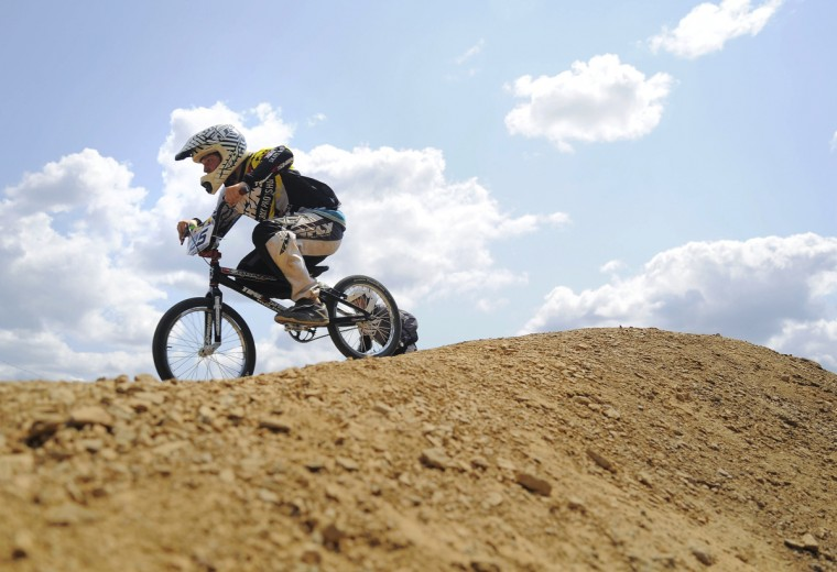 "Grant Raum, 14, of Clear Spring, races in his first race in the 14 expert class during the Quaker State Nationals in Pottstown, PA. Raum did not make it beyond the second round of ""motos"" therefore he did not qualify for the final races on Saturday. Rachel Woolf/Baltimore Sun"