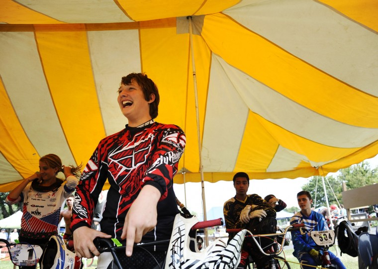 Grant Raum, 14, of Clear Spring, laughs with his competitors before practicing for the Quaker State National races in Pottstown, PA. Rachel Woolf/Baltimore Sun