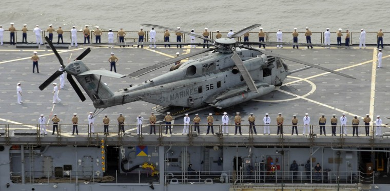 A helicopter is on the deck of one of the many military ships arriving in Baltimore for the Star-Spangled Banner Bicentennial Celebration. Tall ships are also arriving in Baltimore. (Lloyd Fox/Baltimore Sun)