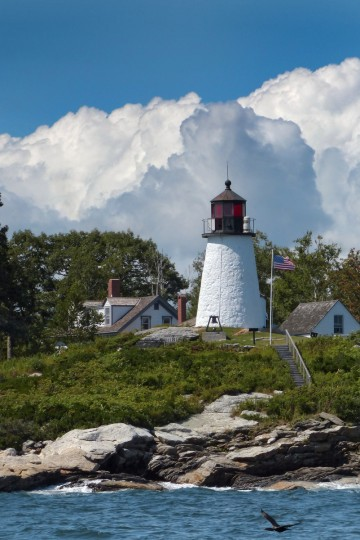 Burnt Island Lighthouse sits beneath puffy summer clouds in Boothbay Harbor, Maine. (Karl Merton Ferron/Baltimore Sun)