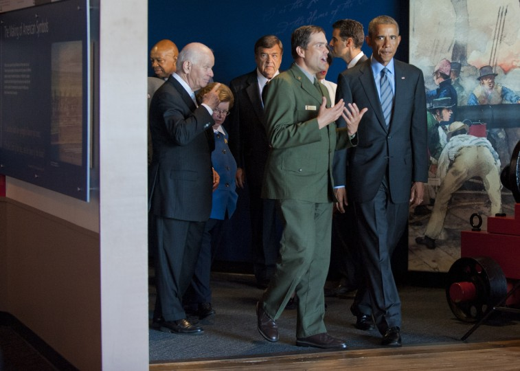 NPS ranger Vincent Vaise walks with President Barack Obama who takes a brief tour with local dignitaries during a visit of the president to the city and Fort McHenry Friday. Karl Merton Ferron/Baltimore Sun