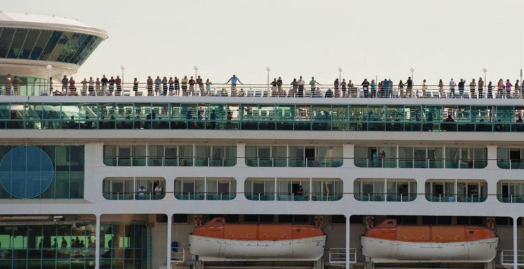 People aboard a cruise ship watch from the deck as the motorcade races up to I-95 toward Pikesville during a visit of the president to the city and Fort McHenry. (Karl Merton Ferron / Baltimore Sun)