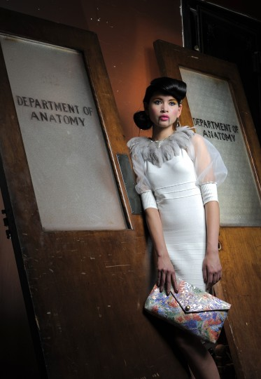 Chez Kevito feather collar, $98, chezkevito.com. Gracia dress, $98, Dollhouse Boutique. Earrings, $140, Amaryllis. Linell Ellis clutch, $318, linellellis.com