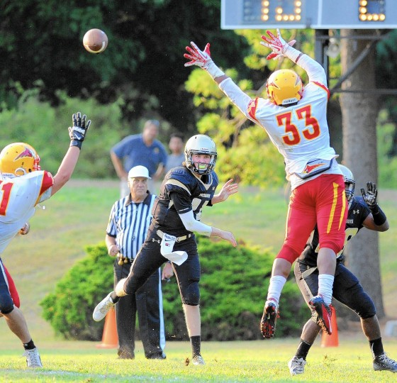 John Carroll quarterback Kurt Rawlings makes the pass during a game against visiting Calvert Hall Friday, Sept. 19. Up 13-0 at the half, John Carroll lost, 14-13. (Staff photo by Matt Button, Baltimore Sun Media Group)