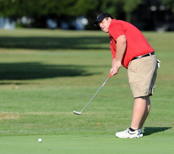 Edgewood's Connor Johnson watches his putt roll toward the hole during a round of golf at Exton Golf Course in Edgewood Tuesday, Sept. 16. (Staff photo by Matt Button, Baltimore Sun Media Group)