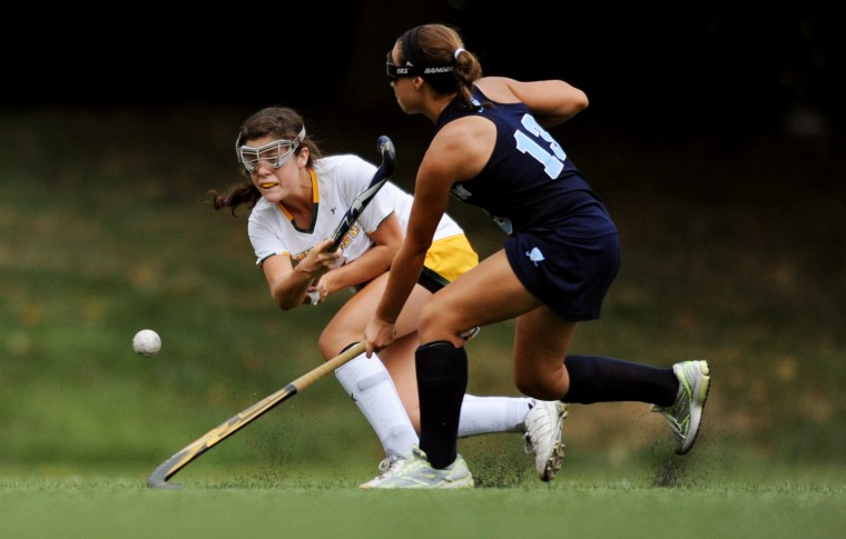 Bryn Mawr's Lily Fisher, left, fires a shot downfield while Garrison Forest's Natalie Ademez tries to block it during a field hockey game at Bryn Mawr School in Baltimore, Thursday, Sept. 11, 2014. (Jon Sham/BSMG)