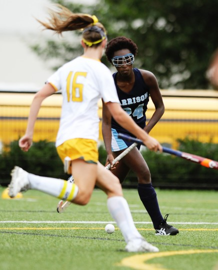 Garrison Forest's Kara Frazier, right, traverses the field with the ball, while Bryn Mawr's Julie Blaze looks for an opportunity to snatch it during a field hockey game at Bryn Mawr School in Baltimore, Thursday, Sept. 11, 2014. (Jon Sham/BSMG)