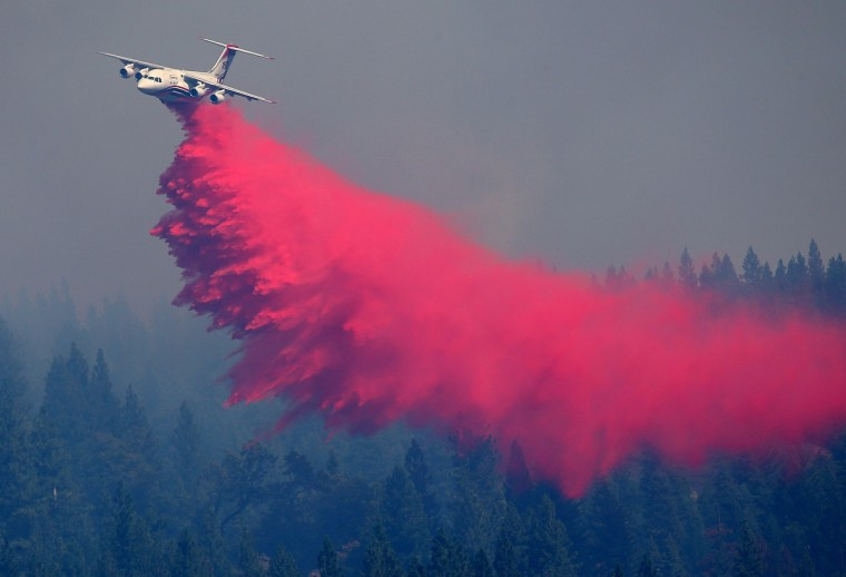 An air tanker drops Foscheck fire retardant on a hillside ahead of the King Fire in Pollock Pines, California. The King fire is threatening over 1,600 homes in the forested area about an hour east of Sacramento and has consumed over 18,544 acres. The out of control fire is 5 percent contained. (Justin Sullivan/Getty Images)