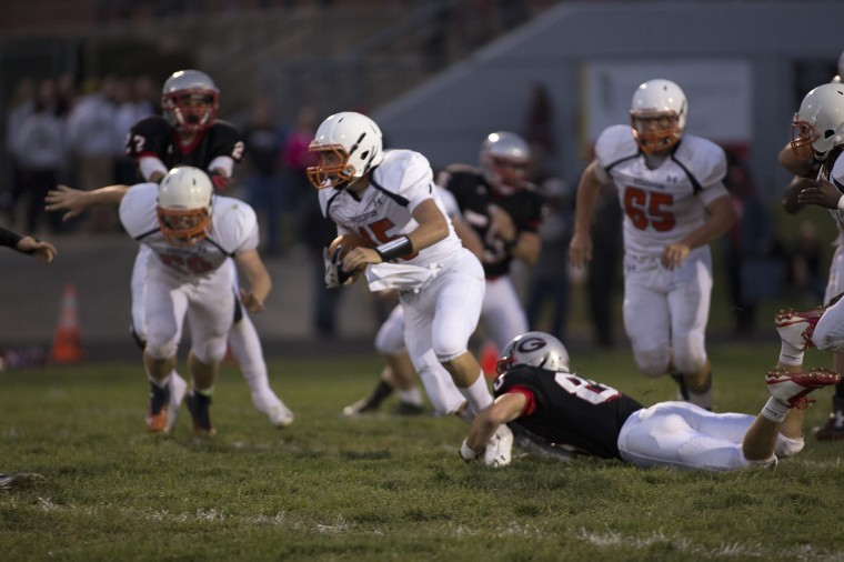 Resevoir High School senior Jack Barry is tackled by a Glenelg player during a game on Friday, Sep. 19th. Glenelg beat Resevoir 34-6. (Photo by James Levin, Baltimore Sun Media Group)