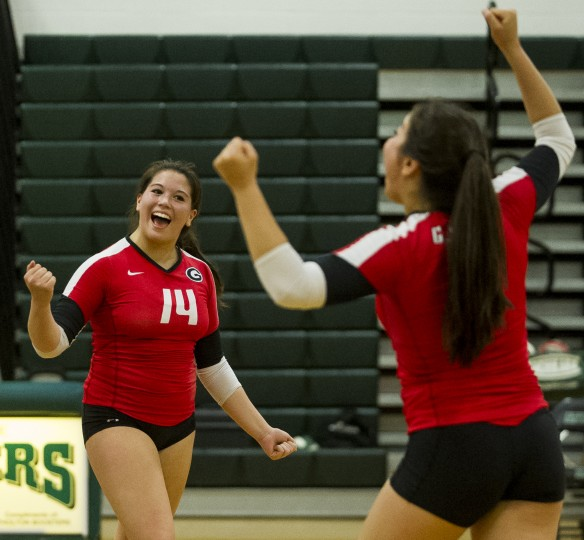 Glenelg's Rachel Girard, left, and Sarah Girard celebrate winning a point during the Atholton vs. Glenelg volleyball game at Atholton Monday, Sept. 15. Glenelg defeated Atholton is four sets. (Photo by Scott Serio, Baltimore Sun Media Group)
