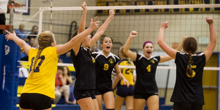 Loch Raven players celebrate winning a pivotal point during a volleyball match against Catonsville Tuesday, Sept. 16, at Catonsville. After losing the first set, Loch Raven won the next three sets to win the match. (Photo by Scott Serio, Baltimore Sun Media Group)