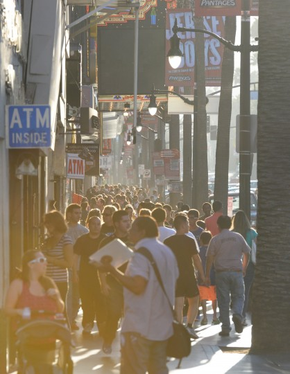 As the sun sets over Hollywood Boulevard, thousands of people crowd the sidewalks and visit the various tourist attractions and gift shops.
